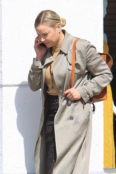 Abbie Cornish on her phone in Beverly 12