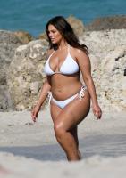 Ashley Graham  Models bikinis on a 21